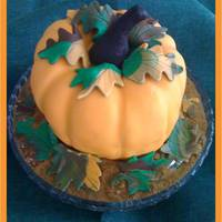 Pumpkin Cake   Vanilla cake covered with fondant..