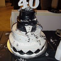 40Th Birthday Top Hat and Tuxedo cake from Fondant and Butter Cream icing with silver dragees.