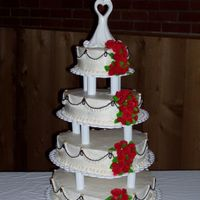 Heart Wedding This was my first wedding cake! It has buttercream icing with fondant roses and leaves.
