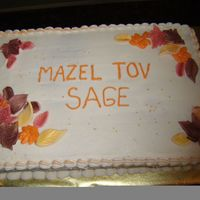 Fall Bat Mitzvah Cake for fall Bat Mitzvah with leaves made of fondant and dusted with luster dust.