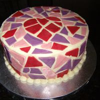 Valentine Mosaic Mosaic tiles were made from candy melts. Used a heart cookie cutter.