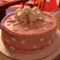 Grandmas Birthday I made this cake using rasberry jam mixed with the buttercream. The cake is french vanilla with rasberry cream filling. Polka dots and bow...