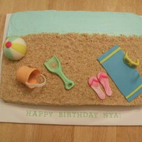 Beach Theme Chocolate cake with fondant and gumpaste decorations