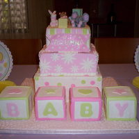 Baby Shower Blocks Vanilla square cakes. The blocks are also vanilla, all covered in homemade fondant. The little figures are made of gumpaste as well as the...