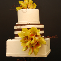 Mixed Shapes Chocolate and vanilla fondant with silk orchids. Thanks for looking!