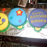 First Fondant Cake   It is baby einstein cake 5 cakes 8 in round all different flavors.