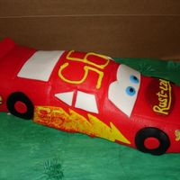 Lightning Mcqueen car formed with rice krispy treats and then covered with fondant.