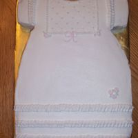 Girl Baby Shower 9x13 cake carved to look like a little girl's dress. I used a drinking glass as a guide to cut out the neckline. Then I carved the...