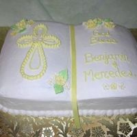Twin Baptism   Yellow cake with strawberry filling. Shaped like a bible with buttercream icing and sugar roses.