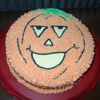 Pumpkin Cake   Single layer spice cake with buttercream icing. Fondant features.