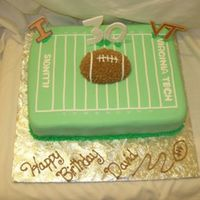 Football Cake  Vegan vanilla cake with coconut filling. Cake is covered in fondant with buttercream covered football on top. Football was made using...