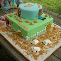 Pumpkin Patch Farm Cake  This cake was for a 3rd birthday party at a pumpkin patch. Bottom tier is chocolate and represents the animals on the farm. Covered in...
