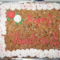 Valentine's Chocolate Chunk Cookie Cake   The Chocolate Chunk cookie cake I made for my husband, and don't laugh at my roses.. it was my first attempt! :)