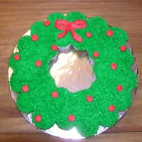 Wreath Cupcake Cake   This is a cupcake cake I did for my husband to take to his co-workers for the holidays.