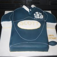 "Scotland Rugby Shirt Carved from 2 8"" square cakes. Getting the colour right was very hard! Thank goodness for ready coloured black and royal blue icing!..."
