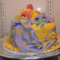"Auction Cake W/ Purple ""fabric Like"" Fondant The cake in side is Lemon...Everything outside is Fondant."