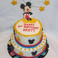 Mickey Mouse Chocolate cake with bc and colorflow accents. The stars are fondant.