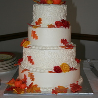 "Fall Wedding Cake Wedding cake for my niece. 12"", 10"", 8"", and 6"". Candy clay flowers, leaves, and pumpkins."