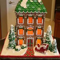 "Traditional Gingerbread House This is my first from scratch gingerbread house. It is 18"" tall. Completely edible. Candy clay roof shingles, butterscotch windows,..."