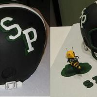Football Helmet Cake This is a cake I made for a cake decorating contest judged by Duff, the Ace of Cakes. It is a helmet of our local youth football league,...