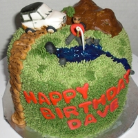 Off Roading Birthday Cake   Just a small 6 inch cake covered in PB icing with fondant jeep and person fishing. Thanks for looking!