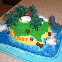 Lost Themed Birthday Vanilla cake with bc icing and fondant decorations (except the trees).Thanks for looking!