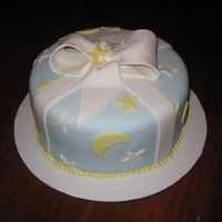 Moons And Stars covered in fondant with fondant accents. the stars are covered in platinum luster dust...hard to see. tfl!!