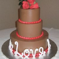 Love And Red Roses chocolate swiss meringue buttercream with red buttercream piping. gumpaste roses and letters. my first gumpaste roses outside of a class....