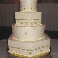Gold And Silver Dragee Wedding Cake Cake is iced in buttercream with gold, silver and pearl dragees added. I really enjoyed decorating it even though it took a while placing...