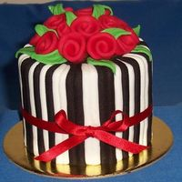 Gift Cake A minature version of the engagement cake in my photos. Sides are straight this time. Black and white stripes, red ribobn roses. 3.5inch...