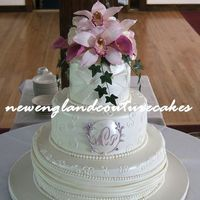 Orchids The details on this wedding cake is a combination of elements from the invitations and bridal gown. The flowers are gum paste and were a...