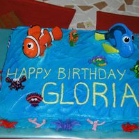 Nemo Cake Sheet cake with teal icing, oversprayed with Wilton Blue food spray....Nemo & Dori are Happy Meal toys....other small characters are...