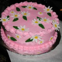 Easterdaisy3.jpg Daisies and leaves were done with Wilton fondant cut and dried over night. Next day I painted them with gel, and dipped in colored sugar.