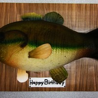 Fish Hand carved cake covered in fondant and air brushed. Fins are made of gum paste.