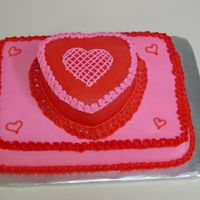Valentine's Cake For Work This cake had a lot of firsts for me. It was my first stacked cake, my first time doing some freehand work- the hearts, and my first...
