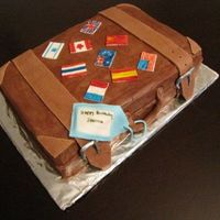 Suitcase Made this cake for a girl who recently took up traveling the world... the flags are all the countries whe's traveled to.