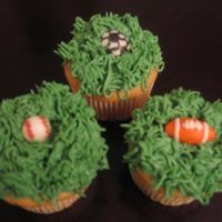 Sports Cupcakes   The balls are made with mmf.