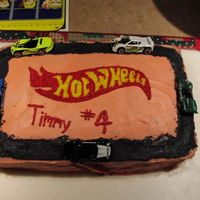 Hot Wheels hot wheels logo created by printing out a picture, cutting it out and tracing into the icing with a toothpick, then filling with stars.