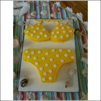 Yellow Polka Dot Bikini Coconut cream cake with buttercream icing. The polka dots and bikini strings were done in fondant....wish I had had the time to put a...