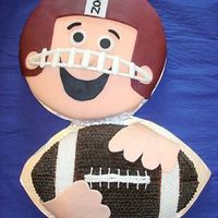 "Football Player And Football  I did this for my son's 9th birthday ""football"" party - it is an idea off the Wilton website. Player is fondant w/ the face..."