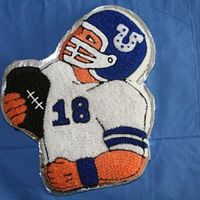 Peyton Football Cake   This was made with the Football Hero Wilton cake pan for my son's 10th birthday. Go Colts!