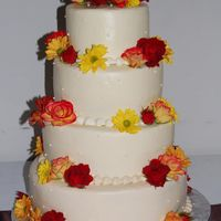 Fall Wedding Cake iced in buttercream with real flowers