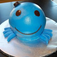 Oswald This was the smash cake for the birthday girl,Oswald is made with the mini ball pan and iced in buttercream, eyes mouth,hat and legs are...