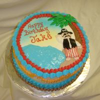 "Shipwrecked Pirate 9"" round vanilla cake with choc bc filling and bc icing. palm tree and pirate hat and vest are mmf ... all else is bc. thanks for..."