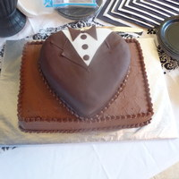 Chocolate Tuxedo Groom's Cake Chocolate buttercream bottom tier....tux is covered with modeling chocolate with white fondant accent.