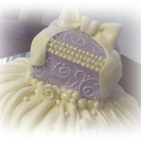 Jewelry Box Fondant covered box with royal icing scroll work and fondant pearls and bow... The bottom tier is covered with fondant pleats and pearls...