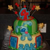 Blue's Clues Birthday Cake This is my oldest son's birthday cake. He loved it! The bottom tier is vanilla cake and the top tier is chocolate cake with cookies n...