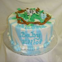 "Baby Zebra 9"" round strawberrry cake with bc icing and bc filling with fresh strawberry slices. zebra, leaves, blue zebra stripes and branches..."