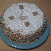 Great Fall Cake This is a yellow cake with Maple flavored Buttercream icing and walnuts around the sides.