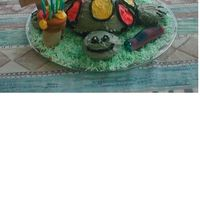 Turtle turtle with mushroom and wooden birthday sign